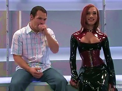 Redhead  In Latex Is A Shemale That Loves Torturing Men