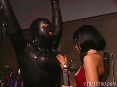 Girl Has Fun Playing With Rubber  Slave