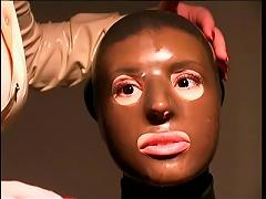 Slave Girl Wrapped In Skintight Latex