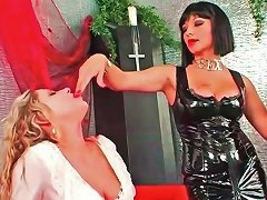 Mistress In Black And Submissive In White At Play